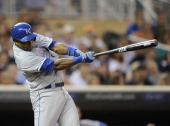 Miguel Tejada of the Kansas City Royals hits an RBI single against the Minnesota Twins during the third inning of the game on July 30 2013 at Target...