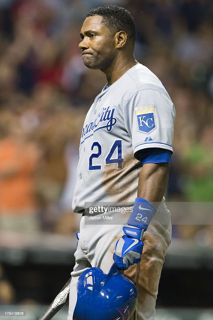 Miguel Tejada of the Kansas City Royals reacts after lining out to first base to end the top if the eighth inning with men on base against the...