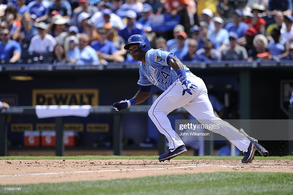 Miguel Tejada of the Kansas City Royals runs to first base against the Detroit Tigers on July 21 2013 at Kauffman Stadium in Kansas City Missouri The...