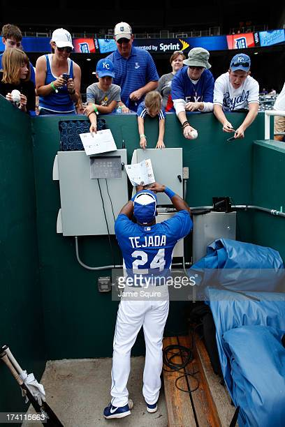 Miguel Tejada of the Kansas City Royals signs autographs prior to the game against the Detroit Tigers at Kauffman Stadium on July 20 2013 in Kansas...