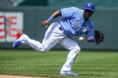 Miguel Tejada of the Kansas City Royals snags a bouncing ball and throws out the Chicago White Sox in the fifth inning on June 22 2013 at Kauffman...