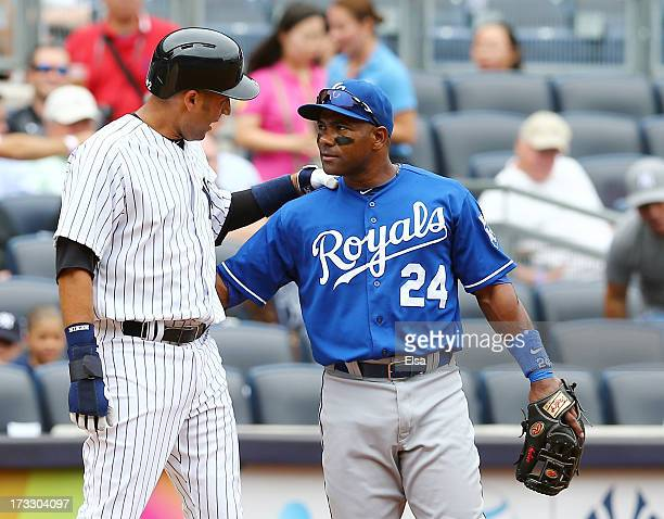 Miguel Tejada of the Kansas City Royals talks with Derek Jeter of the New York Yankees after Jeter is on third base in the first inning on July112013...