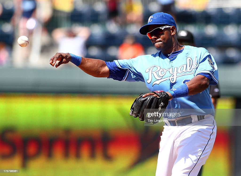 Miguel Tejada of the Kansas City Royals throws to first base in a game against the Detroit Tigers at Kauffman Stadium on July 21 2013 in Kansas City...