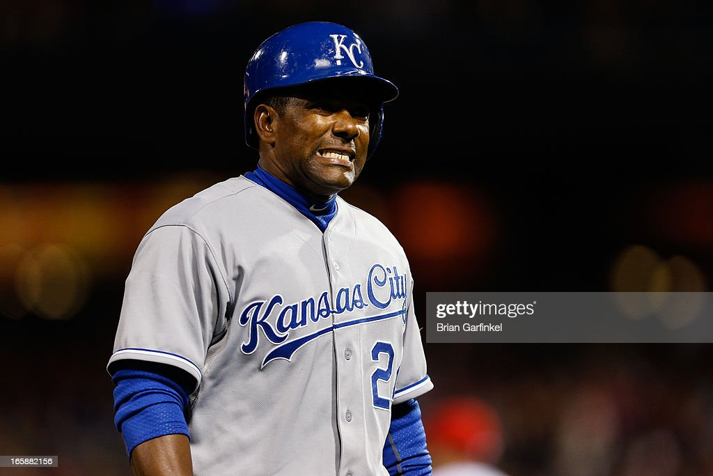 Miguel Tejada #24 of the Kansas City Royals walks back to the dugout after being tagged out at third base in the seventh inning of the game against the Philadelphia Phillies at Citizens Bank Park on April 6, 2013 in Philadelphia, Pennsylvania. The Phillies won 4-3.