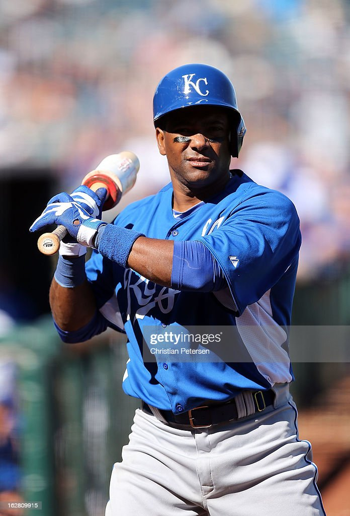 Miguel Tejada #24 of the Kansas City Royals warms up on deck during the spring training game against the Texas Rangers at Surprise Stadium on February 22, 2013 in Surprise, Arizona.