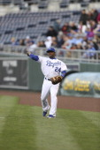 Miguel Tejada of the Kansas City Royals warms up prior to a game against the Toronto Blue Jays at Kauffman Stadium April 12 2013 in Kansas City...