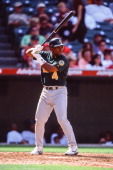 Miguel Tejada of the Oakland Athletics bats during the game against the Anaheim Angels on April 14 2002 at Edison Field in Anaheim California