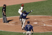 Miguel Tejada of the San Diego Padres points out to second base where Adrian Gonzalez avoided a tag that allowed Tejada to score to give the Padres a...