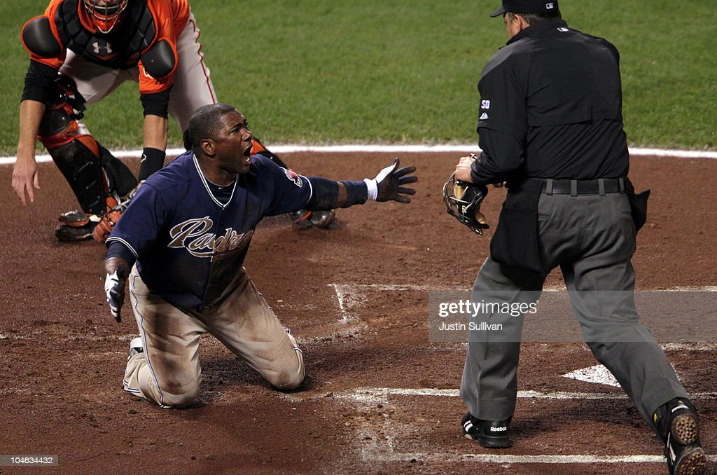 <a gi-track='captionPersonalityLinkClicked' href=/galleries/search?phrase=Miguel+Tejada&family=editorial&specificpeople=202227 ng-click='$event.stopPropagation()'>Miguel Tejada</a> #10 of the San Diego Padres reacts after being tagged out at home plate by Buster Posey #28 of the San Francisco Giants during the first inning at AT&T Park on October 1, 2010 in San Francisco, California.