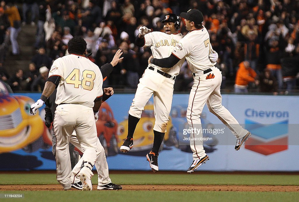 <a gi-track='captionPersonalityLinkClicked' href=/galleries/search?phrase=Miguel+Tejada&family=editorial&specificpeople=202227 ng-click='$event.stopPropagation()'>Miguel Tejada</a> #10 of the San Francisco Giants celebrates with <a gi-track='captionPersonalityLinkClicked' href=/galleries/search?phrase=Mark+DeRosa&family=editorial&specificpeople=228401 ng-click='$event.stopPropagation()'>Mark DeRosa</a> #7 after the game winning hit in the ninth inning against the St. Louis Cardinals at AT&T Park on April 9, 2011 in San Francisco, California.