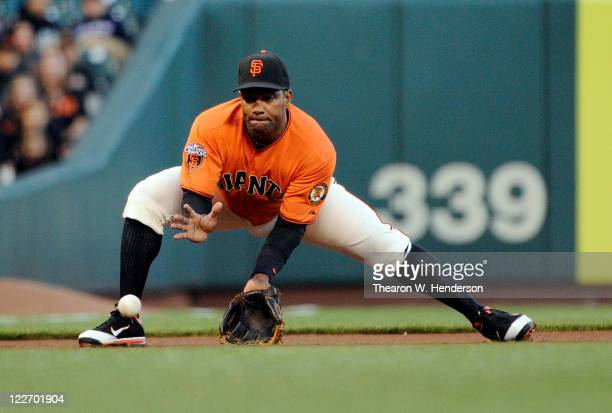 Miguel Tejada of the San Francisco Giants goes down to field a ground ball against the Houston Astros during an MLB baseball game August 26 2011 at...