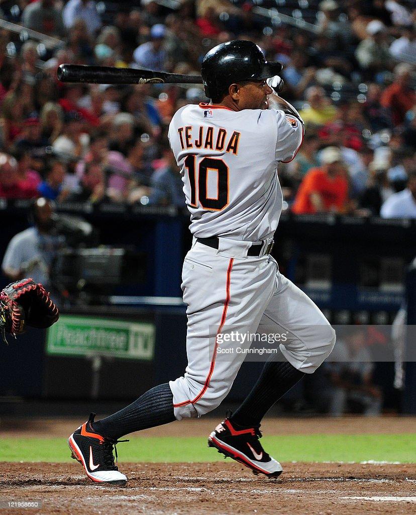Miguel Tejada #10 of the San Francisco Giants hits against the Atlanta Braves at Turner Field on August 16, 2011 in Atlanta, Georgia.