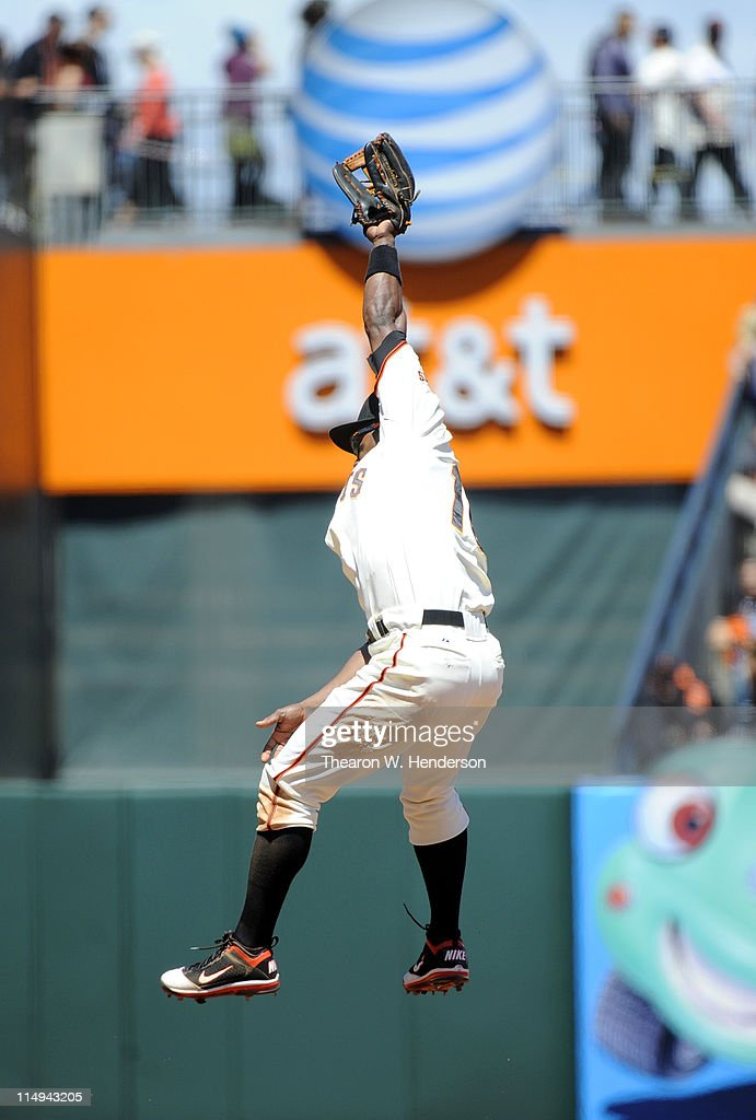 Miguel Tejada #10 of the San Francisco Giants leaps but can't catch a line-drive against the Florida Marlins during a MLB baseball game at AT&T Park May 26, 2011 in San Francisco, California. The Marlins won the game 1-0.