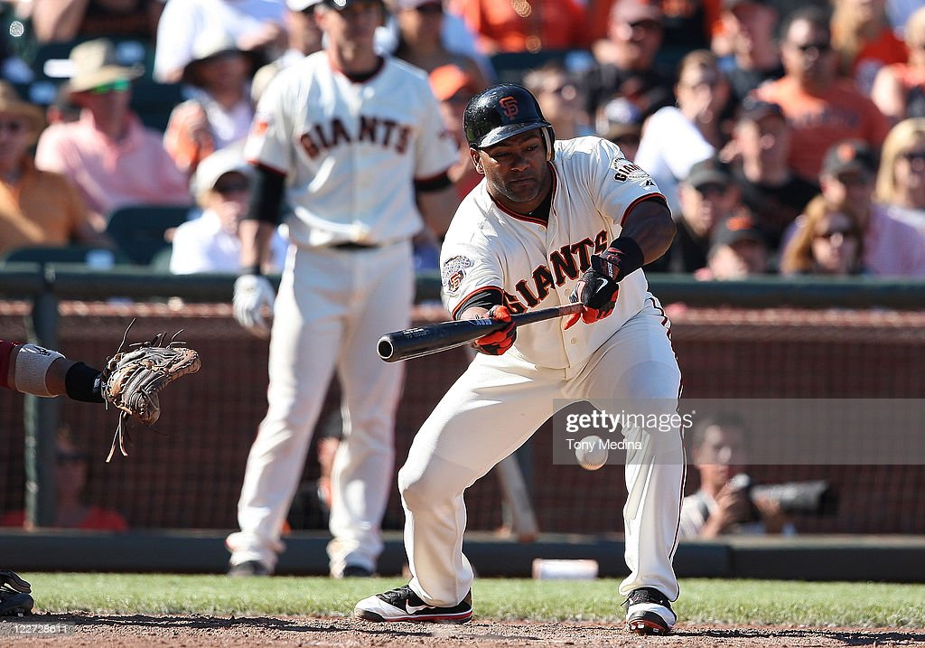 Miguel Tejada #10 of the San Francisco Giants puts down a bunt during a game between the Houston Astros and the San Francisco Giants at AT&T Park on August 28, 2011 in San Francisco, California.
