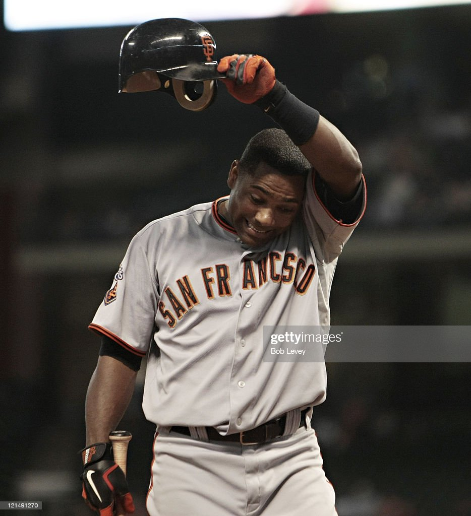 <a gi-track='captionPersonalityLinkClicked' href=/galleries/search?phrase=Miguel+Tejada&family=editorial&specificpeople=202227 ng-click='$event.stopPropagation()'>Miguel Tejada</a> #10 of the San Francisco Giants reacts after he was called for check strike by first base umpire Adrian Johnson in the ninth inning against the Houston Astros at Minute Maid Park on August 19, 2011 in Houston, Texas.