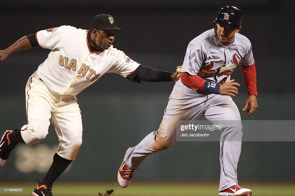 <a gi-track='captionPersonalityLinkClicked' href=/galleries/search?phrase=Miguel+Tejada&family=editorial&specificpeople=202227 ng-click='$event.stopPropagation()'>Miguel Tejada</a> #10 of the San Francisco Giants tags out Jon Jay #15 of the St. Louis Cardinals on a pick off in the seventh inning at AT&T Park on April 9, 2011 in San Francisco, California.