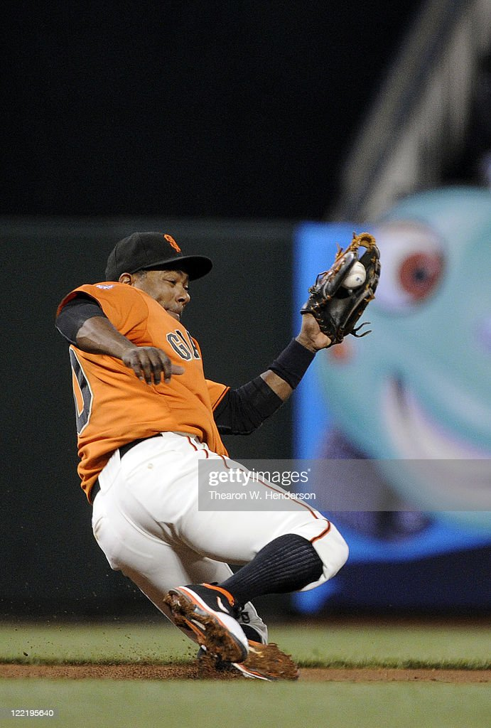 <a gi-track='captionPersonalityLinkClicked' href=/galleries/search?phrase=Miguel+Tejada&family=editorial&specificpeople=202227 ng-click='$event.stopPropagation()'>Miguel Tejada</a> #10 of the San Francisco Giants takes a hit away from Jason Bourgeois #11of the Houston Astros in the third inning during an MLB baseball game August 26, 2011 at AT&T Park in San Francisco, California.