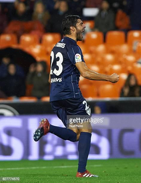 Miguel Torres of Malaga CF celebrates after scoring during the La Liga match between Valencia CF vs Malaga CF at Estadio de Mestalla on december 4...
