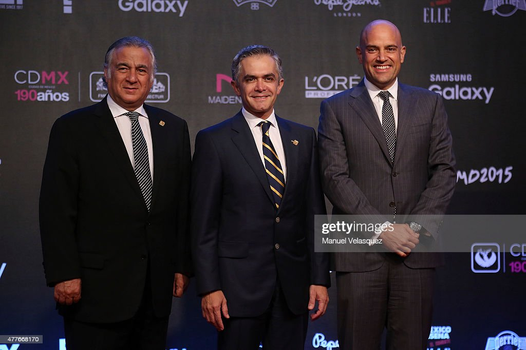 Miguel Torruco Mexico City's Secretary of Tourism (L), Miguel Angel Mancera Head of Government of Mexico City (C) and Manuel Rivera (R) pose prio the presentation of the 9th edition of 'Elle: Mexico Designs 2015' at Bosque de Chapultepec on June 18, 2015 in Mexico City, Mexico.