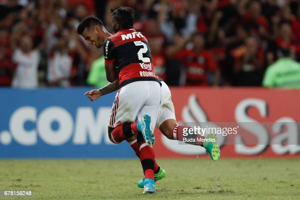 Miguel Trauco and Rodinei of Flamengo celebrate scored goal against Universidad Catolica during a match between Flamengo and Universidad Catolica as...