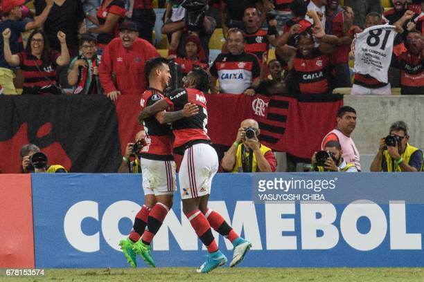 Miguel Trauco of Brazil's Flamengo celebrates with Rodinei after scoring the third goal against Chile's Universidad Catolica during their Copa...