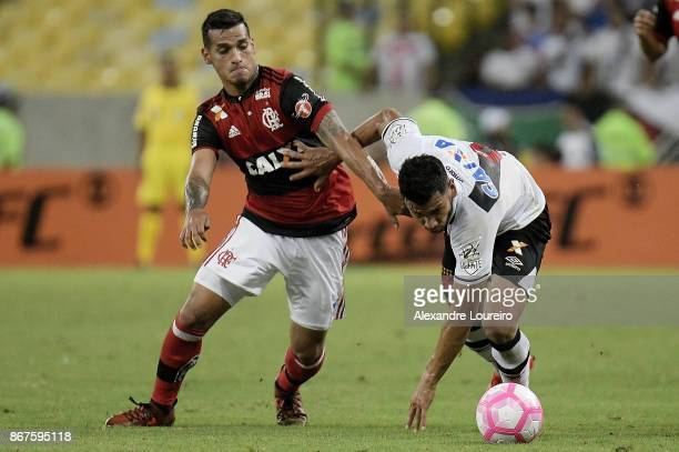 Miguel Trauco of Flamengo battles for the ball with Andres Rios of Vasco da Gama during the match between Flamengo and Vasco da Gama as part of...