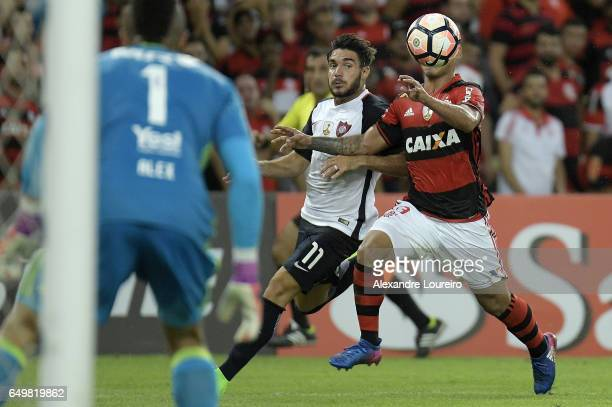 Miguel Trauco of Flamengo battles for the ball with Ezequiel Cerutti of San Lorenzo during the match between Flamengo and San Lorenzo as part of Copa...