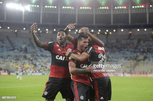 Miguel Trauco of Flamengo celebrates a scored goal with other players during the match between Fluminense and Flamengo as part of Brasileirao Series...