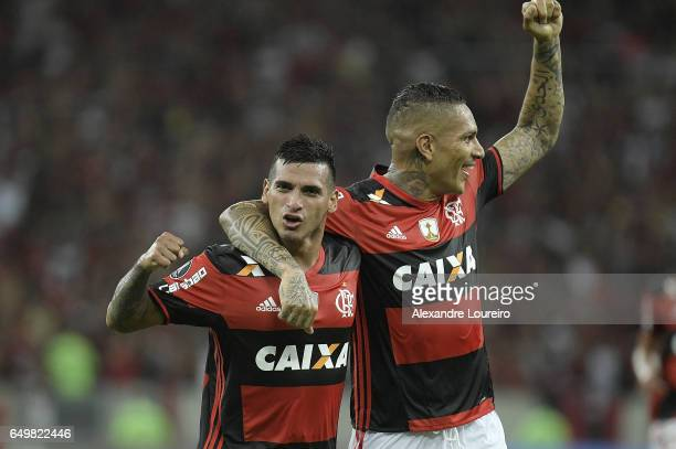 Miguel Trauco of Flamengo celebrates a scored goal with Paolo Guerrero during the match between Flamengo and San Lorenzo as part of Copa Bridgestone...
