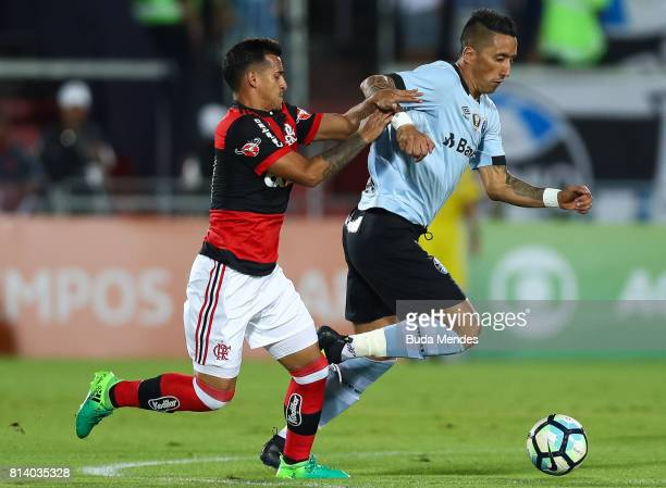 Miguel Trauco of Flamengo struggles for the ball with Barrios of Gremio during a match between Flamengo and Gremio as part of Brasileirao Series A...