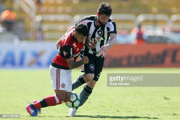 Miguel Trauco of Flamengo struggles for the ball with Joao Paulo of Botafogo during a match between Flamengo and Botafogo as part of Brasileirao...