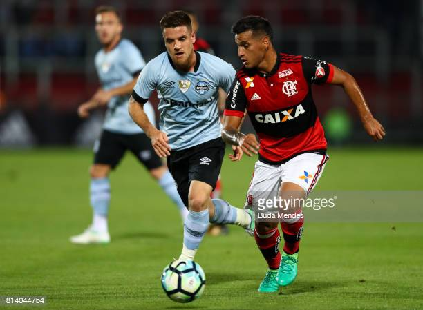Miguel Trauco of Flamengo struggles for the ball with Ramiro of Gremio during a match between Flamengo and Gremio as part of Brasileirao Series A...