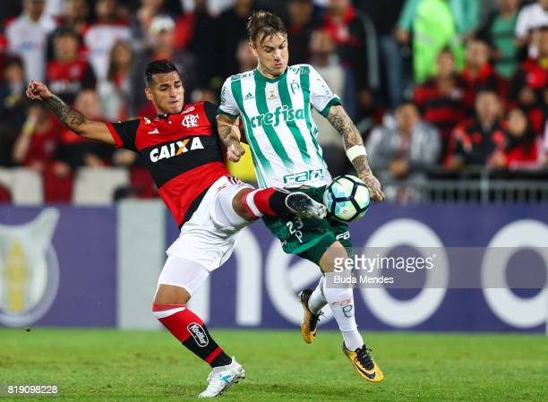 Miguel Trauco of Flamengo struggles for the ball with Roger Guedes of Palmeiras during a match between Flamengo and Palmeiras as part of Brasileirao...