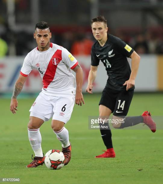 Miguel Trauco of Peru drives the ball while followed by Ryan Thomas during a second leg match between Peru and New Zealand as part of the 2018 FIFA...