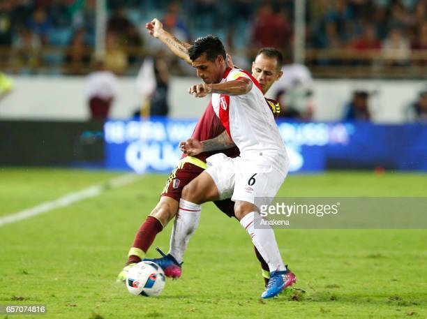 Miguel Trauco of Peru fights for the ball with Alejandro Guerra of Venezuela during a match between Venezuela and Peru as part of FIFA 2018 World Cup...