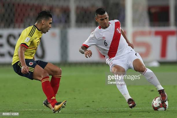 Miguel Trauco of Peru fights for the ball with Radamel Falcao of Colombia during a match between Peru and Colombia as part of FIFA 2018 World Cup...