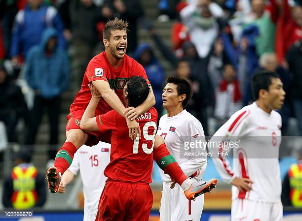 Miguel Veloso of Portugal jumps onto his team mate Tiago after Tiago scored a goal during the 2010 FIFA World Cup South Africa Group G match between...