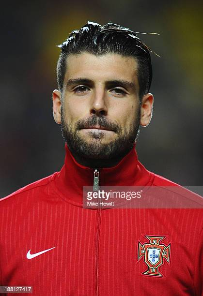 Miguel Veloso of Portugal lines up for the National Anthems during the FIFA 2014 World Cup Qualifier Playoff First Leg between Portugal and Sweden at...