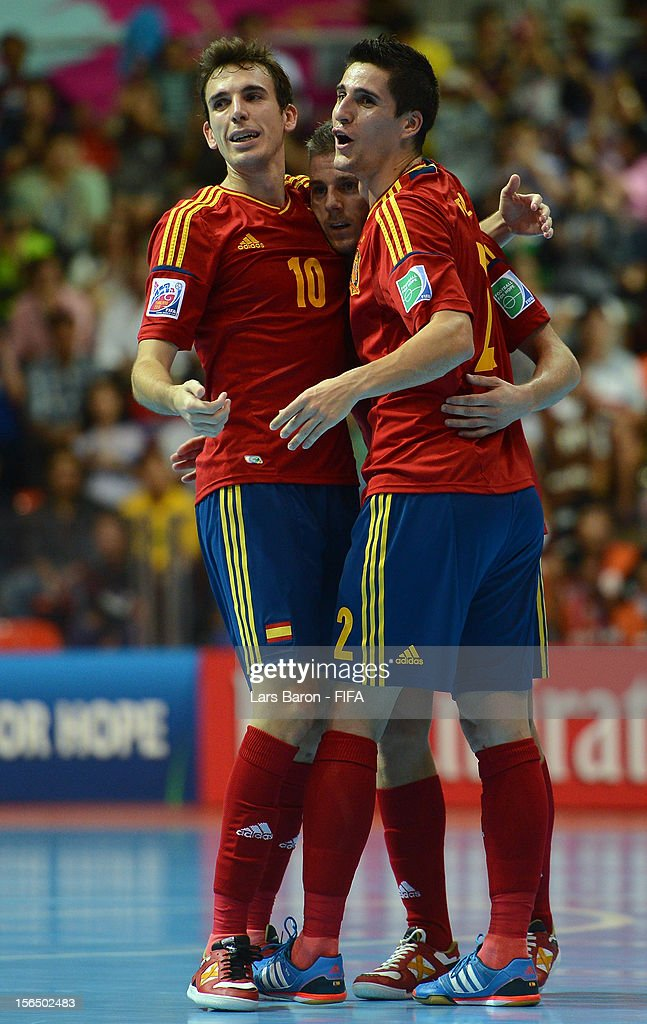 Miguelin of Spain celebrates with team mates Borja and Ortiz after winning the FIFA Futsal World Cup SemiFinal match between Italy and Spain at...