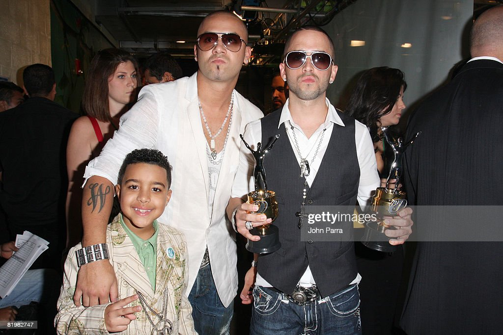 Miguelito and Wisin y Yandel poses backstage at the Premio Juventud Awards at Bank United Center on July 17 2008 in Miami Florida