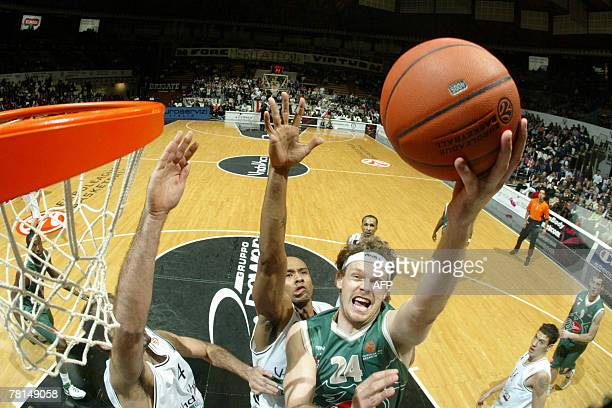 Miha Zupan of Union Olimpija Lubiana tries to score against Delonte Holland of VidiVici Virtus Bologna during the Baskeball Euroleague game in...
