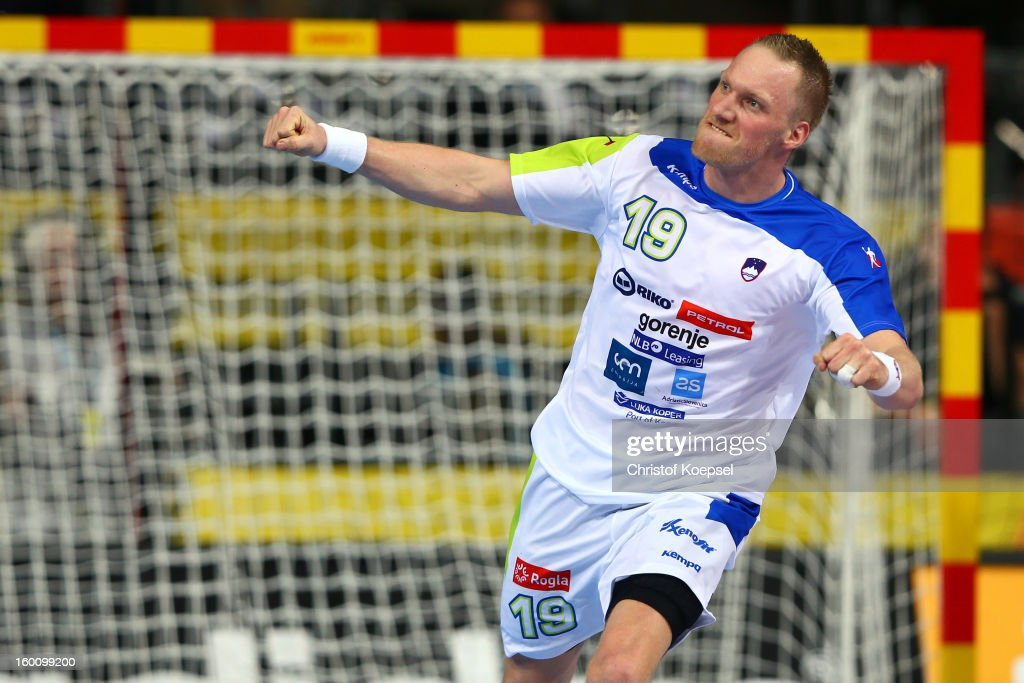 Miha Zvizej of Slovenia celebrates a goal during the Men's Handball World Championship 2013 third place match between Slovenia and Croatia at Palau Sant Jordi on January 26, 2013 in Barcelona, Spain.