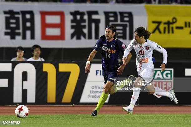 Mihael Mikic of Sanfrecce Hiroshima and Takuya Wada of Omiya Ardija compete for the ball during the JLeague J1 match between Sanfrecce Hiroshima and...