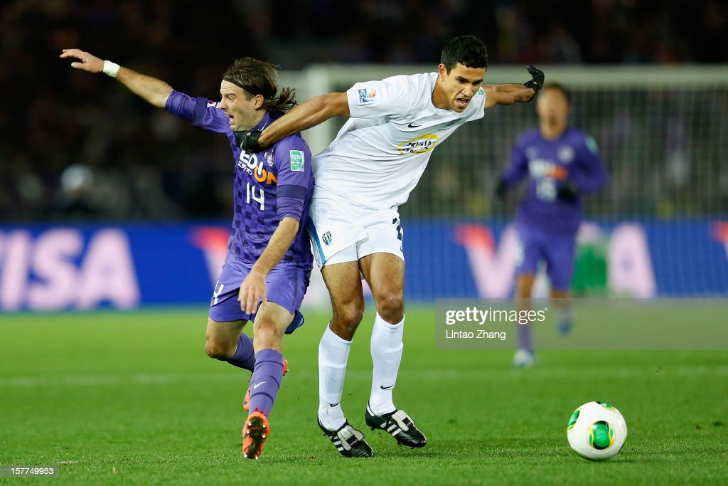 Mihael Mikic(L) of Sanfrecce Hiroshima challenges the ball with Alex Feneridis of Auckland City during the FIFA Club World Cup match between Sanfrecce Hiroshima and Auckland City at International Stadium Yokohama on December 6, 2012 in Yokohama, Japan.