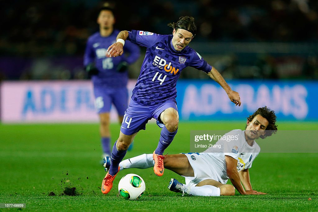 Mihael Mikic(L) of Sanfrecce Hiroshima Squad fights for the ball with Auckland City midfielder Albert Riera (R)during the FIFA Club World Cup match between Sanfrecce Hiroshima and Auckland City at International Stadium Yokohama on December 6, 2012 in Yokohama, Japan.