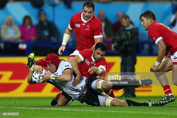 Mihai Macovei of Romania beats the Canada defence as he scores their second try during the 2015 Rugby World Cup Pool D match between Canada and...