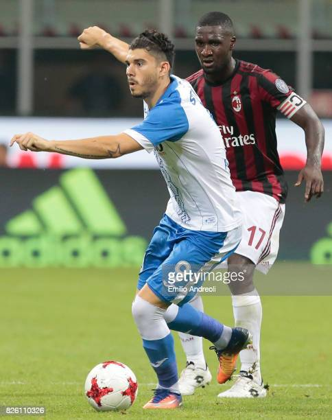 Mihai Roman of CS U Craiova competes for the ball with Cristian Zapata of AC Milan during the UEFA Europa League Third Qualifying Round Second Leg...