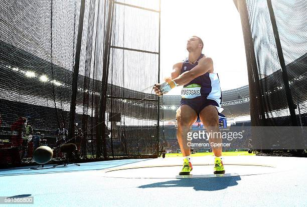 Mihail Anastasakis of Greece competes in the Men's Hammer Throw Qualifying Round on Day 12 of the Rio 2016 Olympic Games at the Olympic Stadium on...