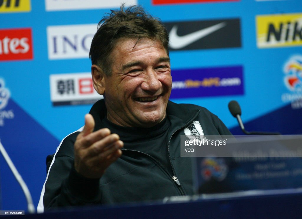 Mihailo Petrovic, coach of Urawa Red Diamonds, smiles during a press conference ahead of the AFC Champions League match between Guangzhou Evergrande and Urawa Red Diamonds at Tianhe Sports Center on February 25, 2013 in Guangzhou, China.