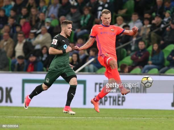 Mihailo Ristic of FC Krasnodar is challenged by Vasili Berezutski of FC CSKA Moscow during the Russian Premier League match between FC Krasnodar v FC...